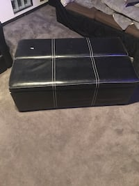 Black and gray leather ottoman