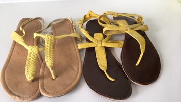 Both pairs of yellow sandals size 7