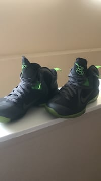 pair of black-and-green Nike basketball shoes San Antonio, 78240