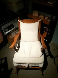 brown wooden frame white cushioned rocking chair