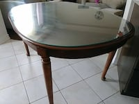 oval glass  top table with brown wooden base