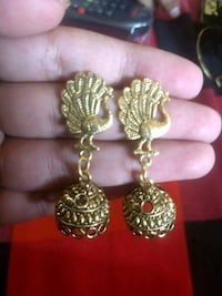 pair of gold-colored earrings