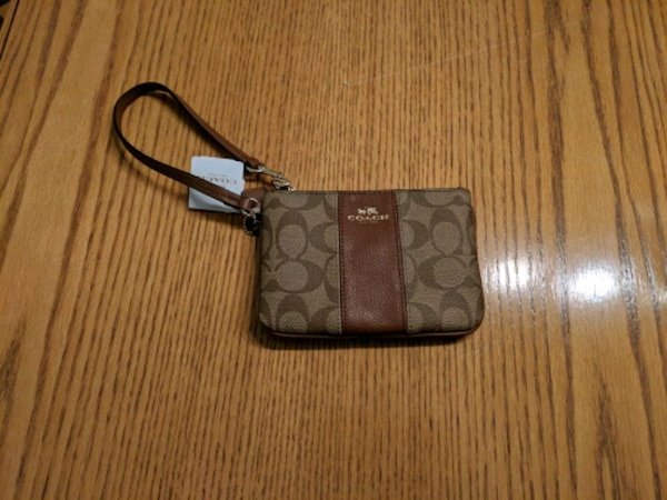 18037d7408c145 Used brown and black Coach monogram wristlet for sale in Milton - letgo
