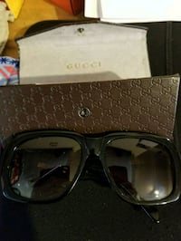 brown and black framed sunglasses Chicago, 60608