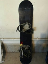 black and gray snowboard with binders