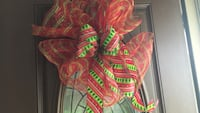 red and orange ribbon wreath