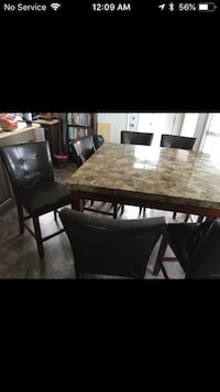 rectangular brown wooden table with four chairs dining set Edmonton
