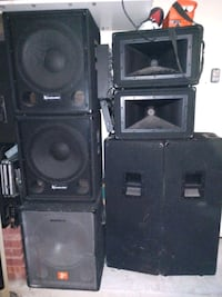 assorted black PA speakers, dual 15 inch subs,  Cypress, 77433