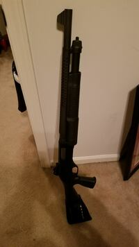black pump-action shotgun
