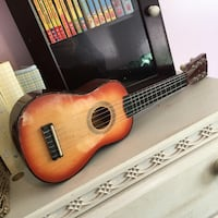 Child play toy wooden music guitar with adjustable strings $10 obo Toronto, M8W 1R5