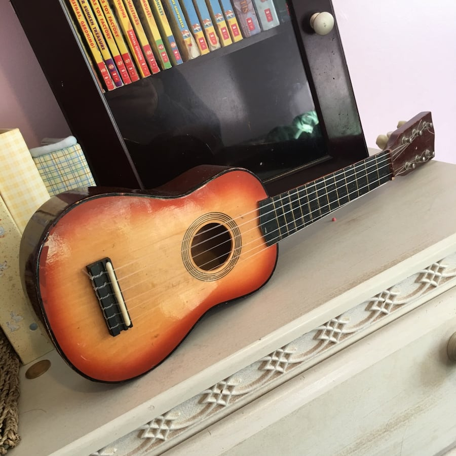 Child play toy wooden music guitar with adjustable strings $10 obo