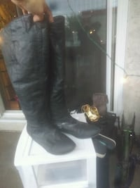 pair of black leather knee-high boots Edmonton, T5H 2Z8