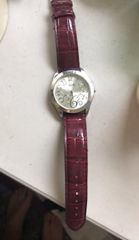 round silver-colored chronograph watch with brown leather strap Portland