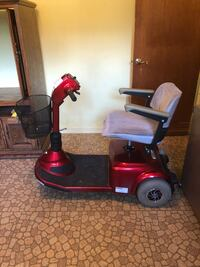 Red and black mobility scooter Leesburg, 34748