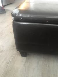 Black leather ottoman with tear on corner, I just put a throw blanket over the corner to cover the tear London, N5Z 1V5