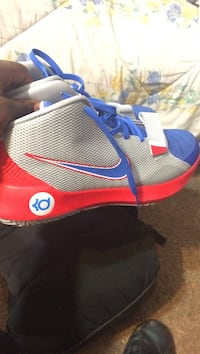 unpaired blue and red Nike basketball shoe Tulsa, 74126