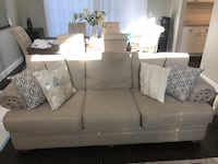 Cream fabric 3-seat sofa 7 1/2 ft long 3 ft wide. gently used