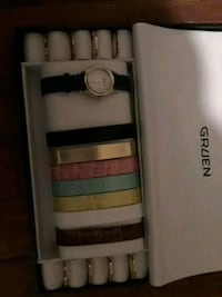 round silver-colored analog watch with assorted-color straps and box Endicott, 13760
