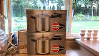 two stainless steel pressure cooker boxes