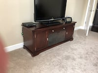 brown wooden tv stand in really good condition.  Oakdale, 95361