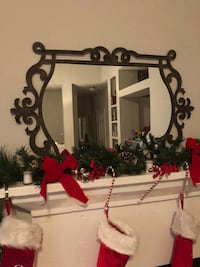 """Can be hung both ways; 41"""" wife and 25"""" tall; black metal frame wall mirror"""