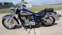 gray and blue cruiser motorcycle