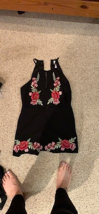 Floral embroidered black romper size Medium. From M Vaughan, L4J 3J8