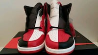 pair of white-and-red Air Jordan shoes Sterling, 20164