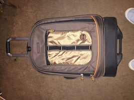 Suit case timberland swivel roll