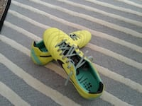 pair of green Nike cleats