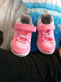 pair of pink Nike running shoes Rockville, 20852