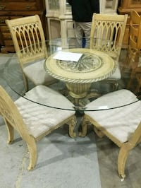 Glass top table and 4 chairs 5 km