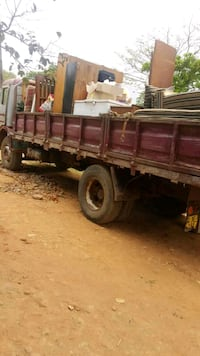 brown and black utility trailer 46 km