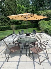 """Patio Table and 4 patio chairs. Glass Table 45"""" diameter. Lancaster, PA"""