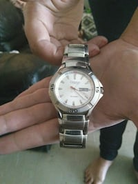 round silver-colored analog watch with link bracelet Winnipeg, R3M 1Y7