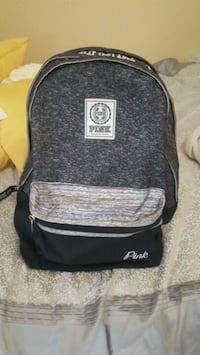 black and gray Jansport backpack 1075 mi