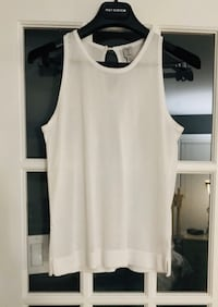 Tristan sleeveless top with button in the back, size small