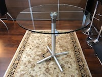 Clear glass top table with stainless steel base, foldable with easy mechanism. In perfect condition Vancouver, V6B 0C2