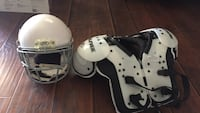 white and black shoulder pads with white sports helmet
