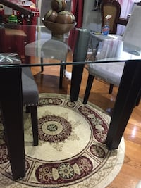 Brand new dinning room table glass top and leather legs   Dimensions (LxWxH) 35.5x35.5x30inches  Brand new in box  Asking: $100 Chairs not included. Chairs sold separately  For more information please contact Richard @  [TL_HIDDEN]  Toronto, M9V 4B8