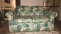 Beach green floral couch small rip in back hardly noticeable  Wilmington, 28403