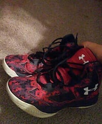 pair of red-and-black Under Armour athletic shoes