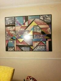 brown wooden framed painting of abstract Alpharetta