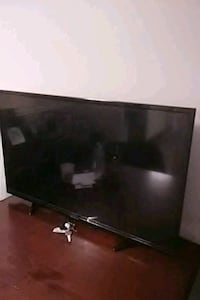 flat screen TV and brown wooden TV stand Nashville, 37115