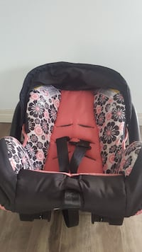 black, pink, and gray floral car seat carrier