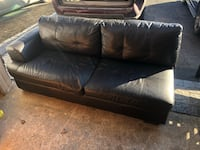 BLACK LEATHER CHASIE COUCH - GREAT CONDITION - FREE DELIVERY AVAILABLE
