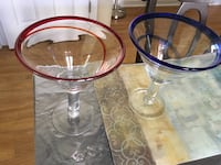Two clear glass footed cups