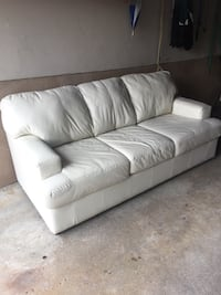 Cream leather sofa bed. Sofa in great condition bed is damaged. Pick up only.  Vaughan