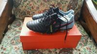 pair of black Nike cleats with box Los Angeles, 90018