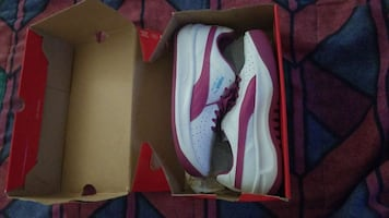 white-and-purple Puma low-top sneaker with box
